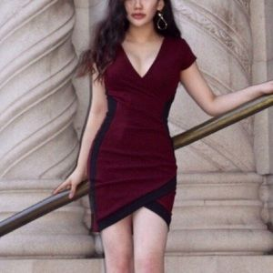 Black and burgundy body con wrap dress